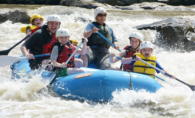family rafting on river dranse in morzine in french alps